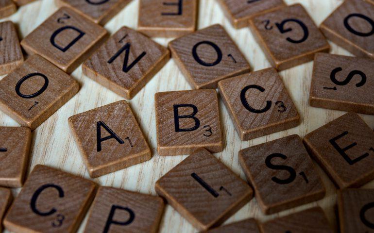 Wooden scrabble tiles spelling ABC